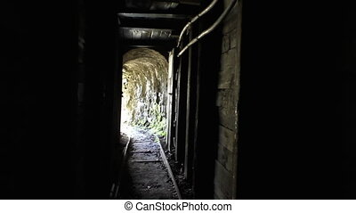 Walking out of an old mine