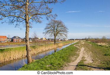 Walking path in nature reserve De onlanden in Eelderwolde, Netherlands