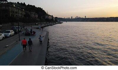 Walking people coastline