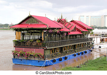 Walking red house-ship on the Mekong River