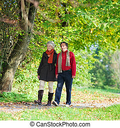 Walking senior couple