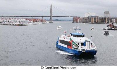 Walking ship floats on gulf of Stavanger against bridge