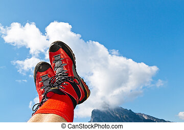 Walking shoes for hiking in the mountains - Red hiking boots...