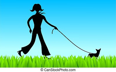 silhouette of a young woman walking a chihuahua dog