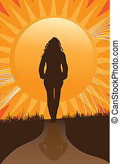 Walking the Path - A woman walks a path towards the sunset...