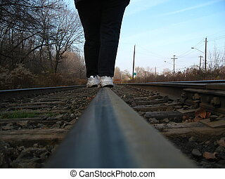 walking the tracks - woman walking a balancing act on train ...