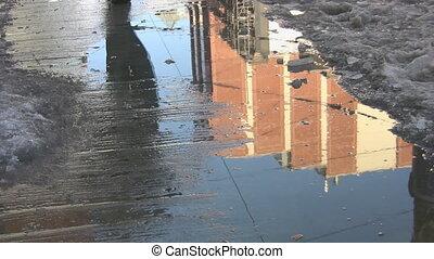 Walking through a puddle.