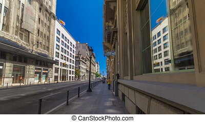 Walking through the streets of Barcelona to monument on...