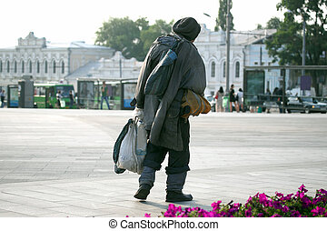 walking through the town square a homeless man