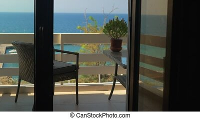 Walking to balcony overlooking the sea - Walking to the...