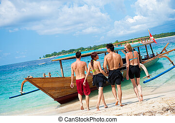 Walking To Boat - Four friends walking towards their dive ...
