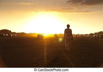 Walking to sunset