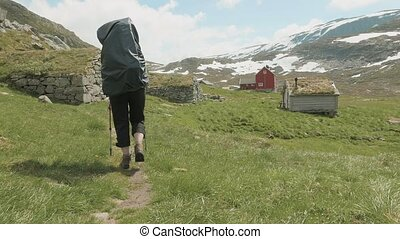 Walking to the village. Grass on the roof, Norway