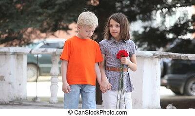 Walking together - Charming kids walking together holding...