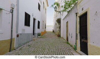 Walking tourists to the historic town of Albufeira. Algarve