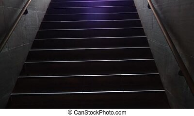 Walking up staircase, exiting the metro