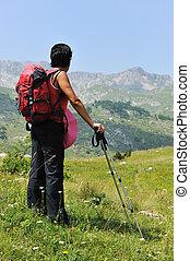 Walking up to mountain hills, sport adventures