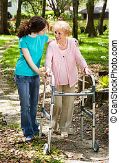 Walking with Grandma - Senior woman and her teen...