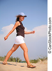 walking woman on sand