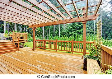 Walkout deck overlooking backyard landscape - Spacious ...