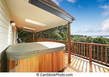 Walkout deck with jacuzzi overlooking scenic bay view