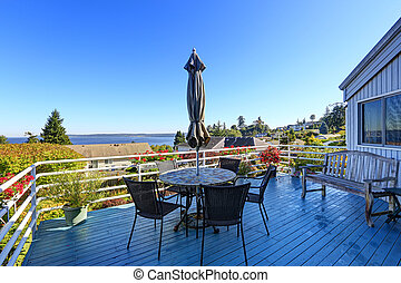 Walkout deck with patio area overlooking scenic bay view in Fede