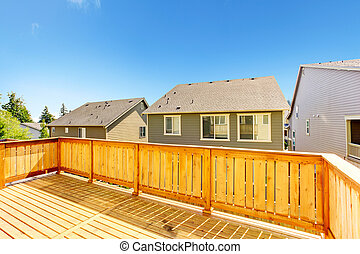 Walkout deck with wooden railing