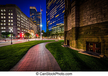 Walkway adjacent to Trinity Church and modern buildings at...
