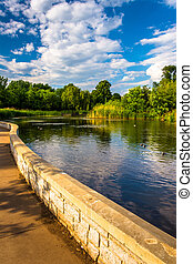 Walkway along a pond at Patterson Park, Baltimore, Maryland.