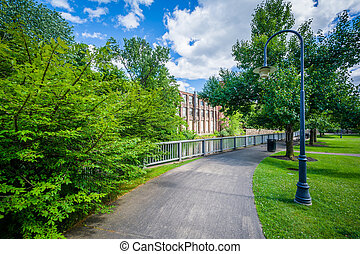 Walkway along the Winnipesaukee River, in Laconia, New ...
