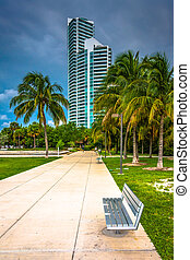 Walkway and distant skyscraper seen at South Pointe Park, Miami