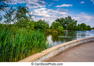 Walkway and pond at Patterson Park, Baltimore, Maryland.