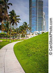 Walkway and skyscraper at South Pointe Park, Miami Beach, Florid