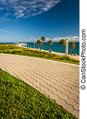 Walkway and view of the Atlantic Ocean at South Pointe Park in M