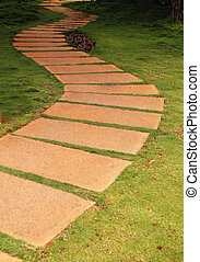 Walkway formed using granite stone slabs in a garden with...