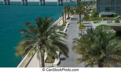 Walkway in Abu Dhabi timelapse with palms - Walkway of Al...