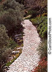 Walkway in the garden .