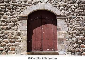 Stone wall and door of church San Fransisco in Potosi, Bolivia