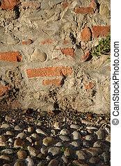 wall and stone pavement