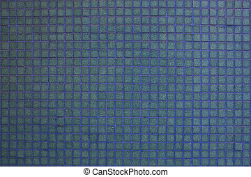 Wall blue tiles with little mosaic squares.