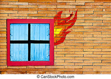 wall brick with window in fire