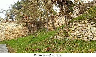 Wall built around sloped hillside in Peru - Wideshot of wall...