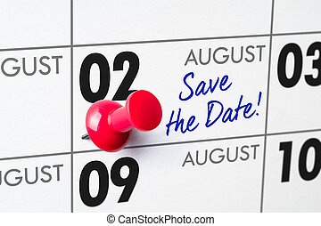 Wall calendar with a red pin - August 02