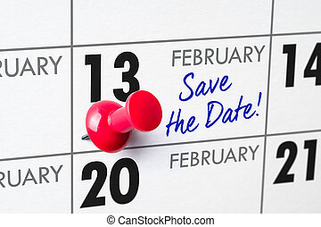 Wall calendar with a red pin - February 13