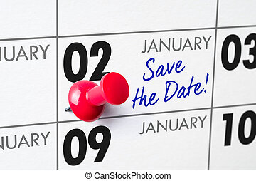 Wall calendar with a red pin - January 02