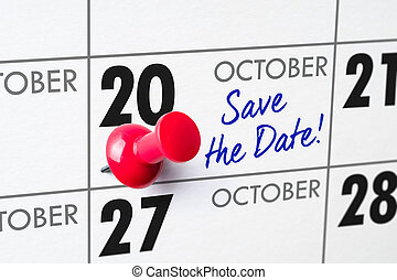 Wall calendar with a red pin - October 20