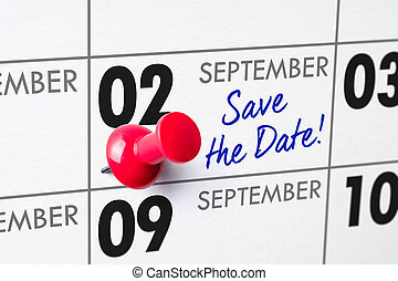 Wall calendar with a red pin - September 02