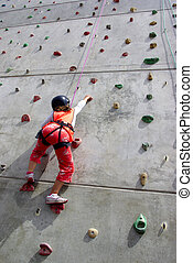 Wall Climbing - Youngster\'s effort in climbing a wall to...