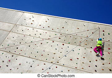 Wall Climbing - Youngster's effort in climbing a wall to...