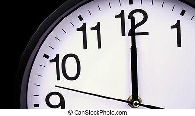 Wall clock on a black 00,00 close-up